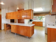 First time on the market since its original construction in The iconic mid century master piece was designed by the team of Joncich and Lusby. Mid Century Decor, Mid Century House, Mcm Furniture, L Shaped Kitchen, Mid Century Modern Kitchen, 1950s Kitchen, Home Kitchens, Modern Kitchens, Modern Cabinets