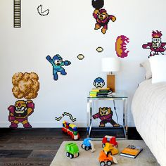 Kids love stickers. Kids love video games. This is a no-brainer. Save yourself a paint job and get your kids excited about decorating their own room. The Mega Man Wall Decalset of graphics is made withmoveable, reusable Blik Re-Stik,and is based on theoriginal Capcom arcade game.