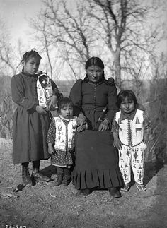 Lucy Knife and children from the Pine Ridge Indian Reservation. Taken in late 1890s.
