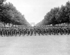 American troops of the 28th Infantry Division march down the Avenue des Champs-Élysées Paris in the Victory Parade.