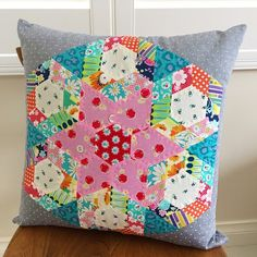 """All finished - my @suedaleydesigns """"Playing with Papers Set 4"""" cushion.  All made by English Paper Piecing and then hand quilted in matching Aurifil 12wt threads."""