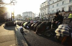 Muslims pray on a street outside the Syrian embassy in London during a demonstration against Syria's president Bashar al-Assad, on 11 February 2012.