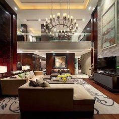 Luxurious-Living-Room-Design-with-Brown-Sofa-Patterned-Carpet-Chandelier-and-Marble-Walls-by-Steve-Leung
