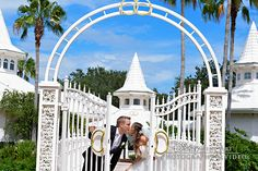 Newlyweds stop for a kiss at Disney's Wedding Pavilion
