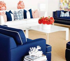 crisp blue and white with a pop of coral.  But minus the white couch cuz that is so impractical with kids and a dog