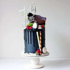 """Cakes by Cliff. """"#BlackFriday cake in all its glory. An interpretation of an Aussie favourite - lamington - vanilla layered cake filled with coconut buttercream frosted in…"""""""