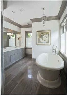 Bleached, 5-inch rifted and quarter-sawn white oak floors. trim color. tub.