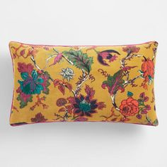 Our stunning mustard-yellow lumbar pillow is made of sumptuously soft velvet and patterned on both sides with a vintage-floral-inspired design. Edged in bright piping, it adds a perfect pop of color to your lounging area.