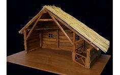 Kerststal met een dak van riet