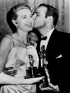 Special Moments...Grace Kelly gets a kiss from fellow Academy Award winner, Marlon Brando, at the Oscars, March 1955.