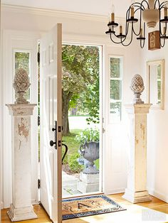 Grab up matching pairs of any type of salvaged architectural element. You'll find that having multiples of similar objects considerably stretches your design options, a point handily illustrated by these two columns, which fashionably frame a front door while performing as pedestals for antique garden ornaments./