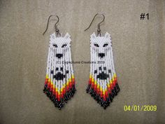 These Beautiful White Wolf earrings are between 3- 3-1/2 long including ear wire. And are made of glass delica beads and bugle beads. Leave your color choice Listing is for 1 pair These earrings are custom made and can take up to 7-10 business days to ship. Usually less