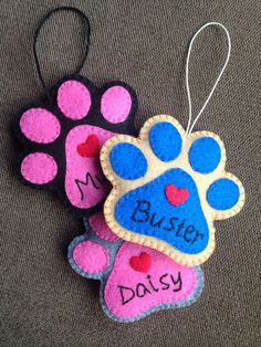 Do not forget your best friend this holiday season. This cute personalized paw print on your Christmas tree is a great way to show that he/she is special. Each and every piece of this ornament is hand-cut, hand-embroidered, and hand-sewn. No adhesive or machine is used. This is lightly filled with hypo-allergenic polyester fiberfil to give it a little body. It has a 3 long cotton hemp code for hanging. Measures approximately 3.25 x 3.25 This ornament can be made in different colors; yo...