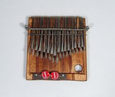32 Key Shona Njari ELECTRIC Mbira - DUAL Pickup - Kalimba - Finger Piano - Thumb Piano ~Zimbabwe by africancraftwork-com. $192.51. Built in DUAL sensor audio pickup for premium sound amplification. One sensor mounted under right keys and second under the left for premium pickup sound. Audio pickup and jack provides excellent amplified fidelity in this new style of workshop assembled Mbira. Includes cable that converts the 3.5 mini jack output to quarter inch male jack....