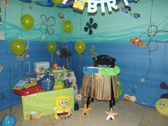 Sponge Bob birthday decorations.  $1 tablecloths, dollar store package of fish, and card board shape cutouts on walls.