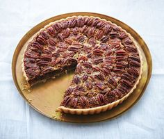 Pecan and Chocolate Tart with Bourbon Whipped Crème Fraîche. Caramel, crunchy pecans, and melted chocolate make up this festive holiday dessert. Thanksgiving Desserts, Holiday Desserts, Holiday Recipes, Thanksgiving Cornucopia, Thanksgiving 2017, Holiday Meals, Christmas Sweets, Creme Fraiche, How To Make Chocolate