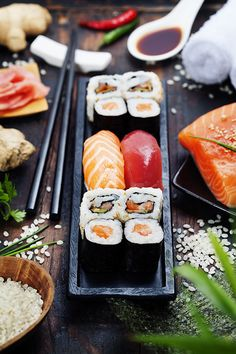 Hero Image: A feature product in the middle surrounded by raw ingredients - rice, salmon , raddish, ginger, soysauce
