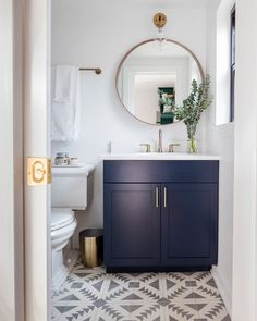 Modern bathroom with navy blue vanity, gold accents, and patterned cement tile. Blue Bathroom Vanity, Navy Blue Bathrooms, Powder Room Vanity, Blue Vanity, Guest Bathrooms, Bathroom Layout, Bathroom Ideas, Bathroom Designs, Boho Bathroom