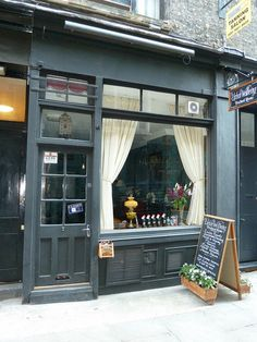 I picture the tea shop looking much like this. Lee Jackson has other wonderful photos as well. http://www.flickr.com/photos/victorianlondon/