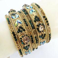 "6 Pcs Green Gold Tone Bangle Set Indian Traditional Bridal Bollywood Churi Kangan Sz 2*8 IBA. $39.99. SALE FOR - Set of 6 Pcs; MATERIAL - Brass. 6 Pcs Green And Golden Bangle Set Indian Churi Sz 2*8. SIZE - 2.5""Inches; COLOR - Green & Gold Tone"
