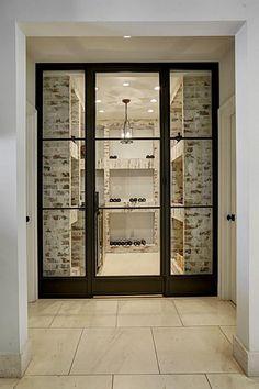 9807 Memorial Dr Houston, TX 77024: Photo  Beautiful brick surround wine room adjacent to kitchen.