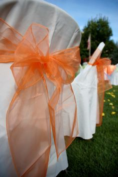Decorate metal folding chairs for gorgeous reception. That would be a ton of fabric...