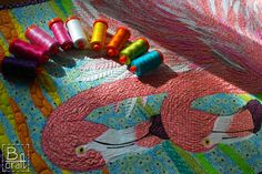 Art quilt with flamingos. A lot of my favorite pink and feathers. All was quilted with different colors of Aurifil WT50.