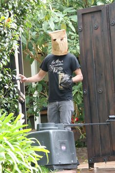 Shia LaBeouf tries to hide his identity by wearing a paper bag mask and plastic bag over his wrist cast as he takes a stroll with a friend in Glendale. Shia forgets to hide his right wrist tattoo.