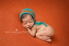 African American newborn boy orange and teal tushie up pose |  Bella Rose Portraits San Diego County newborn and baby photographer photography posing techniques Oceanside, CA