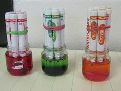 """Make  liquid watercolour paints out of old dried out felt tips-put an elastic band round    5 or 6 dried out water-based markers of a similar colour. Pour  water into glass jars below the screw top area. Put the colour tips of the markers into the water & leave for at least 8 hours ("""",)"""