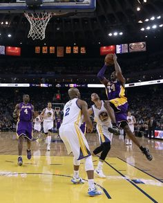 Kobe splits the defense of Jarrett Jack and Stephen Curry (March 25, 2013 | Los Angeles Lakers @ Golden State Warriors | Oracle Arena in Oakland, California)