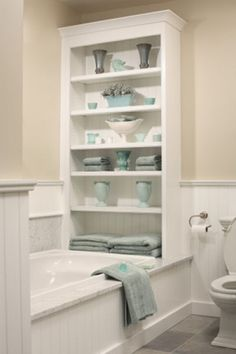 Just like your pretty bathtub bookcase which holds lots of bath supplies <3 More bathroom organization ideas here:  http://thegardeningcook.com/bathroom-organization-ideas/