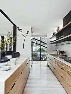 Modern Kitchen Interior Remodeling 8 Amazing Galley Kitchens—and How to Make The Most of Yours via - These small kitchens are quite impressive with their ingenious design. Read on to see these 8 galley kitchen for yourself. Galley Kitchens, House Design, Kitchen Inspirations, Famous Houses, Home Decor Kitchen, Kitchen Interior, Interior Design Kitchen, Modern, Modern Kitchen Design