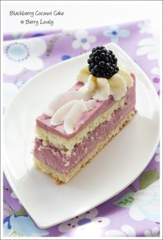 Berry Lovely: Blackberry Coconut Cakes. A light and fluffy coconut sponge with delicious blackberry mousse filling, topped with cream. Beautiful presentation.