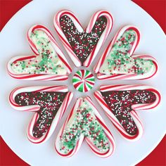 Candy canes shaped like a heart, then filled with chocolate and sprinkles.