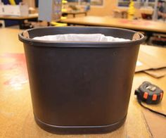 Hack your trash can, Make an insert for those unsightly bags for trash cans with out a lid. http://www.instructables.com/id/Hack-your-trash-can/#step1