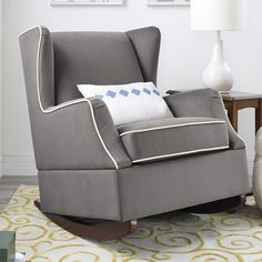 The classic design of the wingback chair is the inspiration for the beautiful Baby Relax Hudson Wingback Rocker. With modern touches such as the co. Rocking Chair Nursery, Rocking Chairs, Glider And Ottoman, Finished Attic, Office Chair Without Wheels, Attic Design, Interior Design, Cool Chairs, Bag Chairs