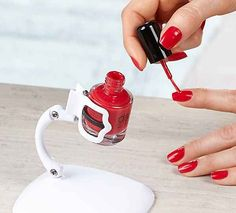 A nail polish holder that lets you tip the bottle for easy painting.