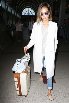 The Comfy Shoes Celebs Wear to the Airport via @WhoWhatWear