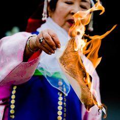 Korean shaman, burning something