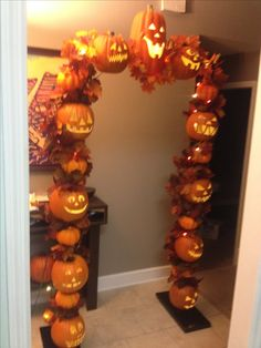 Fall jack o lantern arch made from PVC and foam pumpkins!