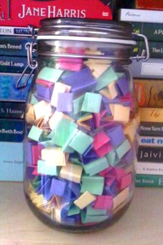 A Book Jar is where you write down titles of books you want to read on little slips of paper and put them in a jar (or whichever container you deem suitable!). Then you pick one out randomly to decide what to read next. <------previous pinner