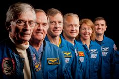 The Crews of STS-1 and STS-135. John Young, STS-1 commander, Robert Crippen, STS-1 pilot, with the STS-135 crew of commander Chris Ferguson, pilot Doug Hurley and mission specialists Sandy Magnus and Rex Walheim. Photo credit: NASA Photo/Houston Chronicle, Smiley N. Pool