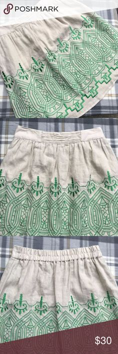 """Madison Linen Skirt with Green Embroidered Detail Madison Linen Skirt with Green Embroidered Detail in great used condition.  100% linen shell, with green embroidery.  Fully lined - 100% Polyester.  The waist in the back is elastic. Measurements laid flat unstretched:  Waist: 15.5"""" (elastic waist in the back) Hips: 22"""" Length: 22"""" Madison Skirts"""