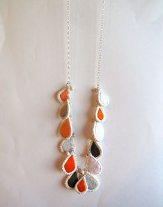 Long embroidered necklace bubble teardrop pendants in grays and oranges with natural beads on silver chain. $70.00, via Etsy.