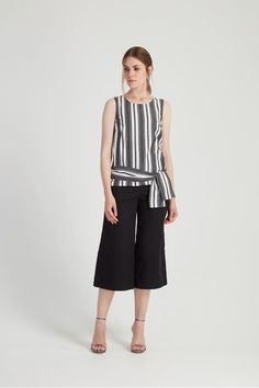 A classic shell top is updated with a tie belt; handwoven stripe in black, grey and white 100% organic cotton.