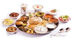 If you are flying Business Class on Singapore Airlines from India, Indian thali is served with favorite accompaniments including chutneys. Enjoy!! #Travel #Trips365