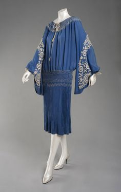Woman's Dress  Made in Philadelphia, Pennsylvania, United States, North and Central America    1925    Artist/maker unknown, American    Bright blue silk plain weave, blue and white smocking, and white embroidery  Center Back Length: 45 inches (114.3 cm)