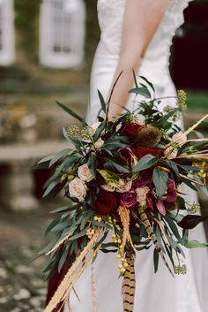 Marsala Bouquet with Pheasant Feathers & Greenery | Winter Wedding Inspiration | Cornwell Manor, Cotswolds | Chris Scuffins Photography | http://www.rockmywedding.co.uk/winter-romance-in-the-cotswolds/