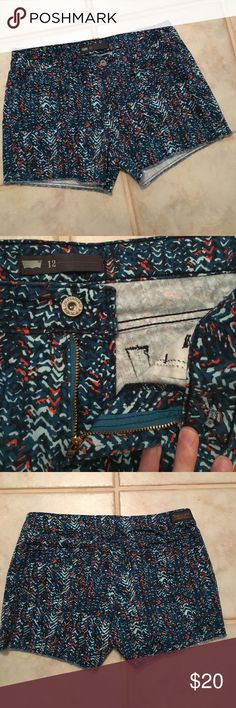 Sunday Sale! NWOT Levi's Printed Shorts New without tags. 99% cotton, 1% elastane. I prefer a little more stretch to my pants so I could not wear these. Very cute orange, Teal, and mint pattern and nice thick denim material. Stylish raw edge hem. Levi's Shorts